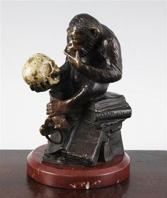Wolfgang Hugo Rheinhold (1853-1900). A patinated and cold painted bronze sculpture 'ape with skull', also known as the philosophising monkey, signed and with foundry mark H. Gladenbeck and Sohn, on a rouge marble base, 7.5in.