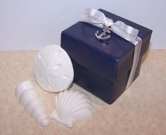 Navy Blue Favor Box with Chocolate Shells and Anchor Charm for Nautical Wedding or Party