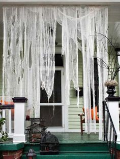 {creepy on a stick} attach shredded cheesecloth, garbage bags bags or burlap to a separate piece of trim, then attach it to the underside of your fascia. When it's time to put away, simply detach the trim and roll up — ready for next year!  #halloween #halloweenoutdoors #halloweenparty