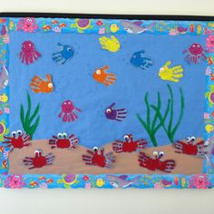 "Make a card that's an underwater scene with kids handprints as fish, and seaweed from crepe paper, and bubbles from earbud dots of paint, and write ""We'll miss you in our school!"""