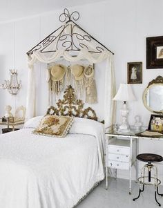 How about this eclectic room with a  rococo headboard and vintage items.