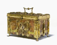 This exquisite casket is adorned with lions and gilt metal fleurs-de-lys, and is characteristic of French Gothic decoration of the 14th century. The richness of the decoration and the themes chosen, suggest that it would originally have belonged to a prince or nobleman. Painted and gilded wood, with gilt copper alloy mounts, European, circa 1400