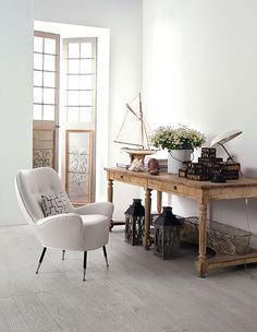 Love the whites and raw wood colors.