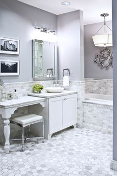 Marble Tile Bathroom Pictures this traditional white master bathroom features white shaker-style