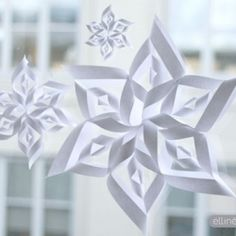 Make festive paper snowflakes with our printable snowflake templates and tutorial. These snowflakes make perfect Christmas decorations.