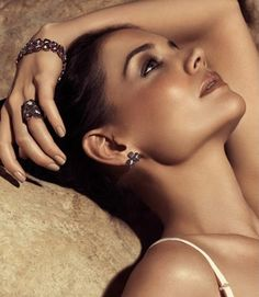 Katie Holmes posing for the jewelry company H. Stern campaign shot by Tom Munro
