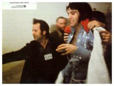 Elvis is whisked away after a performance by Joe Esposito