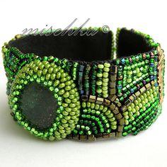 green embroidered bracelet