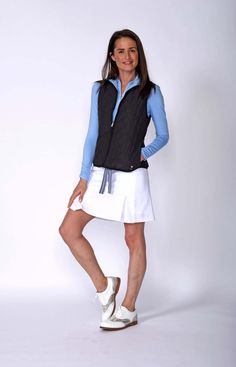 Golftini ladies Blind Date skort made with all white performance fabric and a detachable belt