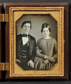 "Quarter Plate Daguerreotype Portrait of a Young Couple, in a brown, ""Floral Scroll"" (Krainik 68) Union case, (minor dust, minute verdigris spot u.l., wiped l.l., case with minor edge nicks)."