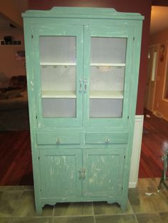 This is a great china cabinet that I repainted years ago.  It is a Jadite green shabby chic feel with glass handles.  It has been the home for my Luray Collection for years and would make a wonderful furniture piece for a new collectin.