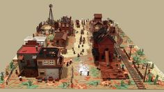 Train station with a telegraph office? Check. A stagecoach entering the town? Check. A saloon, a sheriff's office, a cattle ranch and a bank? Check. Kris Kelvin's giant LEGO diorama is not the typical abandoned Old West boom town. It's full of life and features.
