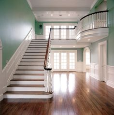 Hardwood floors, beautiful white trim & architectural details, lots of windows, blue-green wall color