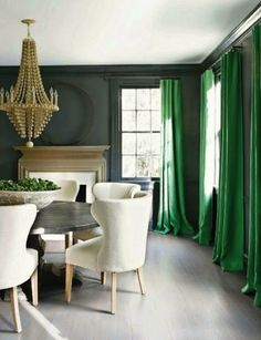 Love this color with the dramatic green floor length drapery & zinc table for our dining room. Verandah Mag March 2012