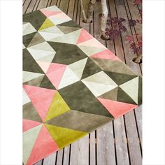 Tielles Rug is a modern geometric rug which features a beautiful mix of pink, green and greys. The colours in this geometric rug take their inspiration from the wildflowers and heathers seen around the coastline of Guernsey, and the shadows cast on the dramatic rocky cliff faces. The mix of pink and green colours with the modern geometric pattern create a joyful and warming design. Rug Yarn, Wool Rugs, Living Room Colors, Rugs In Living Room, Yarn Colors, Colours, Pink And Green, Coral Pink, Modern Area Rugs