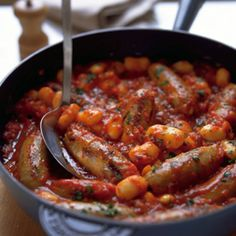 Sausage and bean stew - A warming, simple one-pot meal that's perfect for chilly late-winter evenings. You can use any flavour sausage you like; the texture works wonderfully with the tender beans and rich, hearty tomato sauce Sausage And Bean Casserole, Sausage Stew, Beans And Sausage, Uk Recipes, Sausage Recipes, Casserole Recipes, Dinner Recipes, Lunch Recipes, Recipies
