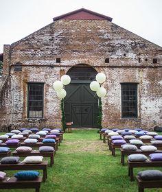 Balloon ceremony decor + pillow bench seating