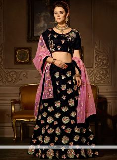 Grab the second look in this elegant attire for this season. Add a vibrant burst of color to your wardrobe with this black velvet a line lehenga choli. The ethnic embroidered, lace, resham and zari wo...