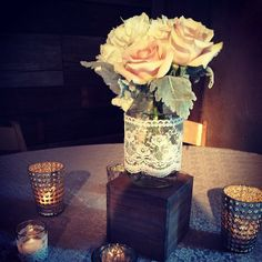 mason jar centerpiece | lace wrapped mason jar | blush rose and dusty miller centerpiece | wood and mercury glass centerpiece | the barn at bridlewood | ms wedding florist | lace tablecloths