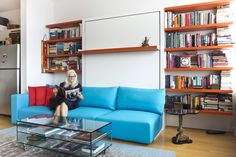 Dwell - Two Film Industry Veterans Flip the Script With a Suburb-to-City Move Resource Furniture, Door Shelves, Shelf, Living Spaces, Living Room, White Doors, Murphy Bed, Film Industry, New Homes
