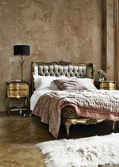 Antique-style french headboard from graham and green, married with sumptuous furnishings, and what looks like a beautiful polished plaster wall