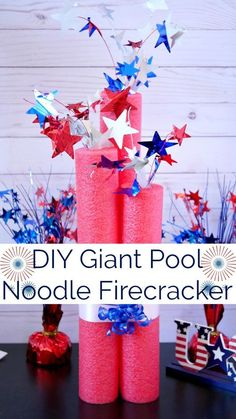 Use red dollar store pool noodles to create DIY Giant Pool Noodle Firecracker Decorations for table, mantel, and party decor. #dollarstore #poolnoodle #firecracker #july4th #patrioticdecoration #patriotic #dollarstorecraft #red #stars