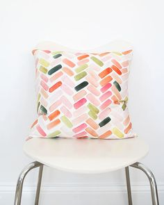 The colors in this pattern was inspired by a group of colorful vases, and the herringbone-like design was used to create movement and interest.