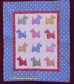 Little Scotties baby quilt. Die cut Scotties were machine appliqued with buttonhole stitch. Hand quilted.