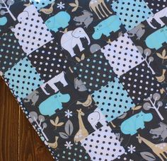 Blue & Gray Animal Baby Boy Quilt - I like this as a basic pattern!  So easy to replicate and swap out with your own colors :)