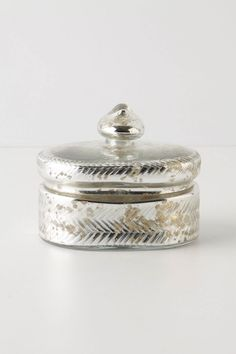 Mercury glass trinket boxes, have 3 different sizes. Displayed in our art deco curio cabinet in our hallway, but would be great for bathroom counters for cottonballs, q-tips, etc.
