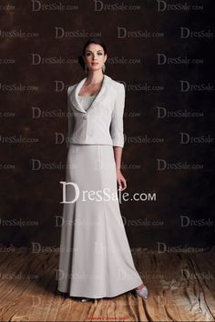 Two-piece silky crepe suit, sleeveless sheath dress with softly curved neckline and crinkled chiffon bust line adorned with delicate pleats, pleated shoulder straps,shinmy empire waistband, matching jacket with three-quarter length sleeves, crinkled chiffon shawl collar and cuffs, accented with jewel button closure.