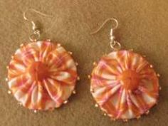 Yo-Yo Earrings | Thoughtful, hand-made gifts do not need to be extremely elaborate or difficult to make. Here are a couple of ideas for some fun earrings any young lady will be delighted to wear. This is a great stocking stuffer!