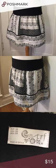 Zara TRF black-and-white pattern skirt This is the fun black-and-white skirt from Zara by TRF, black-and-white woven pattern, two layers, black waistband, side zipper. Be sure and check out other items in closet and bundle to receive discounts. Zara Skirts