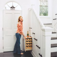 Looking for a place to store your wine bottles? How about a pull-out installed in the void beneath your stair landing? | Photo: John Ellis | thisoldhouse.com