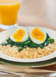 Start your morning off on the right foot with this protein packed, savoury breakfast of a soft boiled egg over quinoa and spinach. | livinglou.com