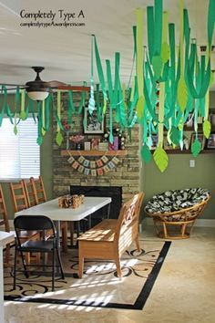 Green Crepe paper used as hanging plants for Jungle Theme.