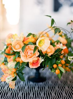 Lovely. #wedding #events #centerpiece #flowers #orange #linen #black #white