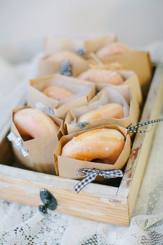 PARTY IDEAS * DONUTS WRAPPED IN PAPER BAGS WITH TINY RIBBONS AND SERVED IN A WOOD BOX. Using parchment paper will give a rustic country look. ** See comments for my directions.