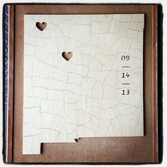 A shaped wooden puzzle wedding guest book designed by Bella Puzzles™. It can be made in the shape of almost any state, province, country, or other geographic boundary. Personalized with hearts, names, or dates.