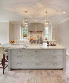 Classic White painted kitchen cabinets with a Zinc paint kitchen island from Dura Supreme Cabinetry.