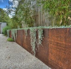 Image from http://www.gabion1.com/corten-steel-retaining-wall.jpg. The corten steel is a decorative veneer infront of the permanent retaining wall which is most often a reinforced concrete wall or a concrete masonry block wall. In years to come the steel cladding may need to be replaced as it rusts away. This is on of the many architectural solutions used by designers to dress up a plain concrete retaining wall.