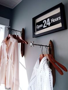 Cute DIY hanging racks for the laundry room. This idea for the clean clothes occupies less space and is prettier than a ordinary hanging rod.