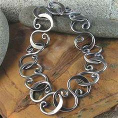 Industrial:  An oxidized, hammered link bracelet in sterling silver  sold by industria via Etsy.