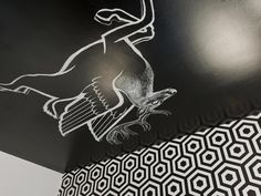 When creating a chalkboard surface, don't forget the fifth wall. Get inspired while you sleep with a bold, hand-drawn graphic, like this Pegasus seen on Home by Novogratz.