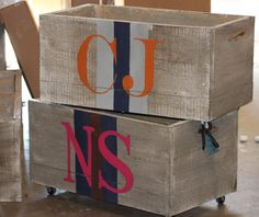 Stripes and monogram on wood box with casters.