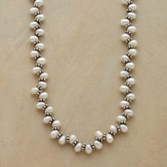 "BACK AND FORTH NECKLACE -- In this handmade pearl necklace, oval cultured pearls jut left and right between sterling silver bead discs. Exclusive with lobster clasp. 16""L."