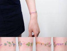 Floral bracelet tattoo. Tattoo artist: Sol Tattoo