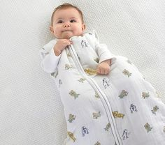 Keep your little PADAWAN™ warm on the go with this wearable, galactic-style blanket featuring YODA™, and It's crafted from pure organic cotton muslin so it's breathable, lightweight and durable. Kids Ca, Muslin Baby Blankets, Storing Baby Clothes, Wearable Blanket, Stroller Blanket, Baby Milestones, Pottery Barn Kids, Organic Cotton, Pure Products