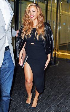 Beyoncé Knowles in a black maxi, black leather moto jacket, and black heels