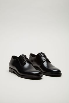 COS image 2 of Lace-up leather shoes in Black